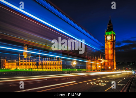 Long exposure view of traffic by Big Ben, London, United Kingdom - Stock Photo