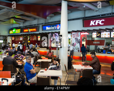 India, Mumbai, Santa Cruz Domestic Airport, passengers in T2 new departure terminal food court - Stock Photo