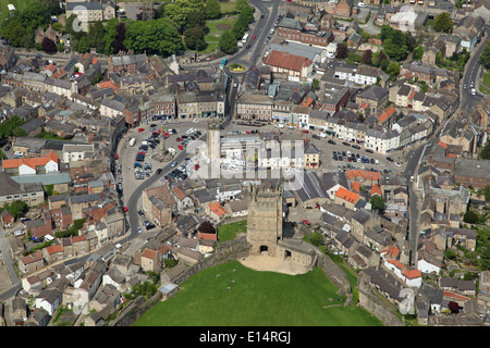 aerial view of the North Yorkshire market town of Richmond with its sloping cobbled market square and famous Castle - Stock Photo