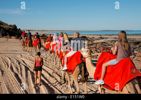 Australia, Western Australia, Broome, Cable Beach. Sight-seeing camel ride along Cable Beach and the Indian Ocean. - Stock Photo