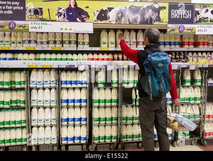 Milk in Tesco supermarket - Stock Photo
