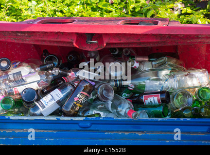 Glass recycling container in supermarket car park - Stock Photo