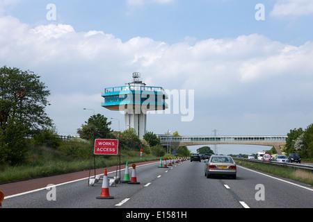 roadworks closed lane and pennine tower of lancaster forton services M6 motorway lancashire uk - Stock Photo