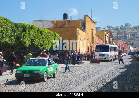 Busy bus and taxi stop Colegio San Miguel de Allende Mexico - Stock Photo