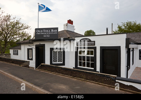 the old toll bar first and last house in scotland on the england border - Stock Photo