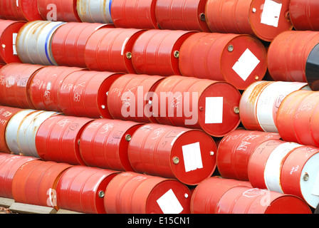 Used 55 gallon chemical drums in a storage yard awaiting recycling - Stock Photo