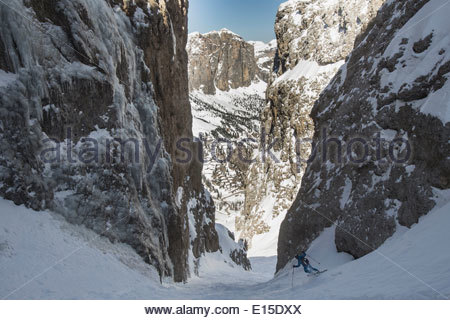 Italy, Dolomites, Val Gardena, Man backcountry skiing - Stock Photo