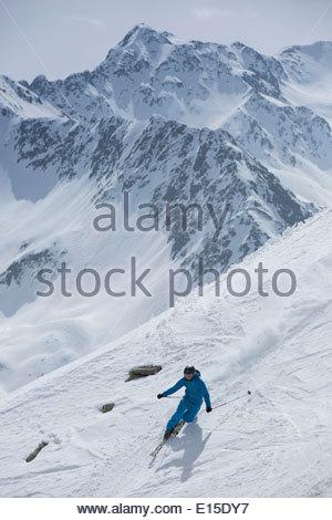 Austria, East Tyrol, Defereggental, Man telemark skiing - Stock Photo