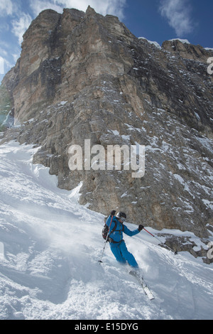 Italy, Dolomites, Val Gardena, Man telemark skiing - Stock Photo