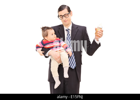 Young father holding his daughter and a bottle of juice - Stock Photo