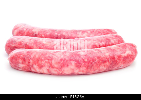 a pile of uncooked pork meat sausages on a white background - Stock Photo