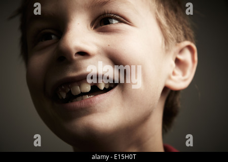 Boy smiling with tooth gap - Stock Photo