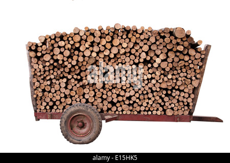 firewood on a trailer, isolated on white background - Stock Photo