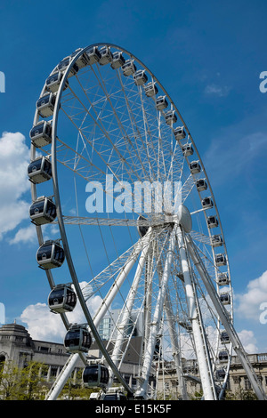 Big wheel in Piccadilly Gardens in Manchester city centre UK - Stock Photo