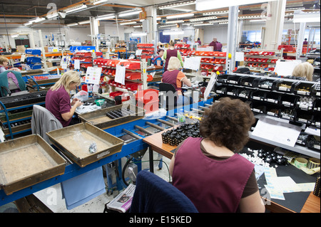 Assembly Workers On A Factory Shop Floor Assembling Electrical Switchgear No Faces Can Be