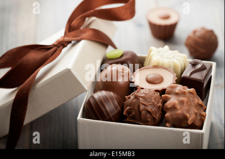 assorted chocolates confectionery in their gift box - Stock Photo