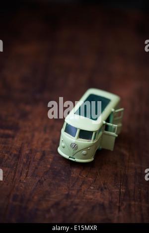 Old Matchbox Lesney VW caravette model oy car on dark wood - Stock Photo
