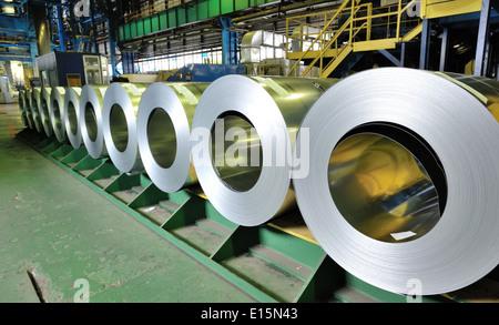 rolls of steel sheet inside of plant - Stock Photo