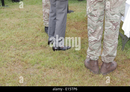 Duke of Kent royal visit  Devon County Show Exeter UK view of his shiny shoes on wet muddy grass feet - Stock Photo