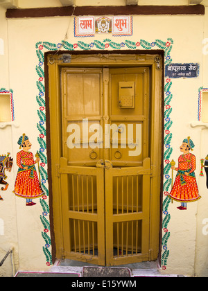 India, Rajasthan, Udaipur, door of home decorated with traditional wall painting - Stock Photo
