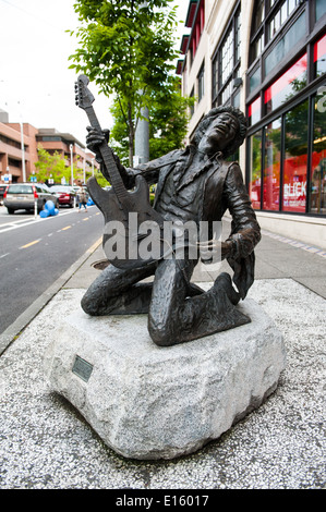 A bronze statue of Jimi Hendrix stands in the Capitol Hill neighborhood of Seattle. - Stock Photo