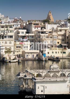 India, Rajasthan, Udaipur, Moun Mandir, temple in Lake Pichola with Jagdish Temple on skyline - Stock Photo