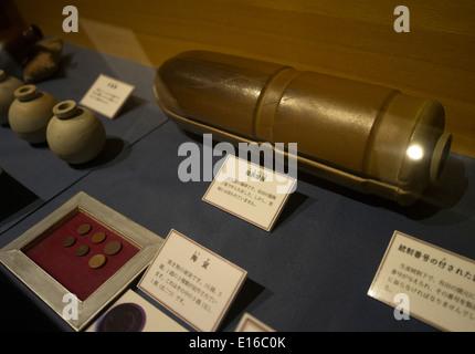 Bombs, coins and grenade made from pottery at . Arita Folk and History Museum, Arita, Saga Prefecture, Japan. - Stock Photo