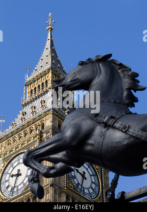 Abstract view of Big Ben with A bronze horse in front of it - Stock Photo