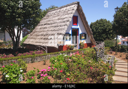 Palheiro thatched house and flowers Santana Madeira - Stock Photo