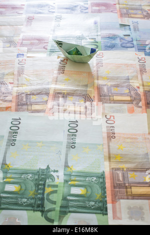 Boat from Euro bank notes - Stock Photo