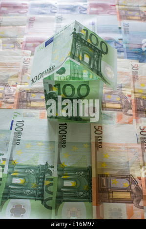 House made from Euro banknotes - Stock Photo