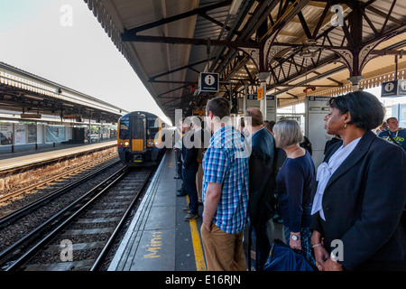 Commuters Waiting For A Train, Clapham Junction Railway Station, London, England - Stock Photo