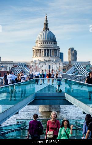 People Walking Across The Millennium Bridge, London, England - Stock Photo