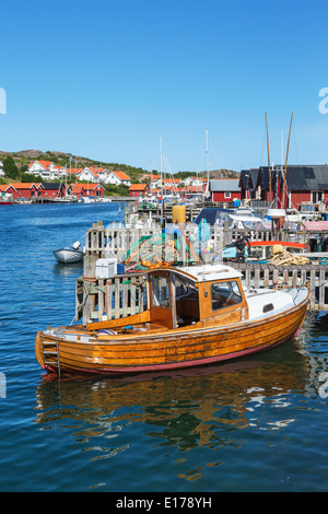 Old wooden boat in the harbor of a fishing village on the Swedish west coast - Stock Photo