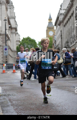 London, UK. 25th May, 2014.  : Thousands participate men, women and children runs for the Bupa Westminster Mile - Stock Photo