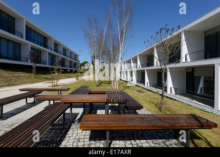 Picnic table in park next to modern architecture buildings - Stock Photo