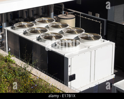 Large industrial air conditioning units on a building rooftop - Stock Photo