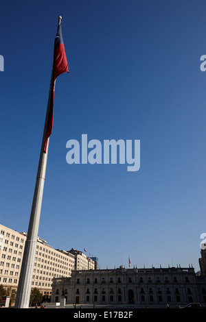 large bicentenary flag and la moneda palace in citizens square Santiago Chile - Stock Photo