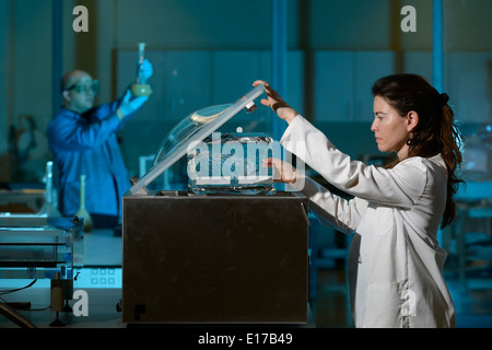 Scientists working in lab - Stock Photo