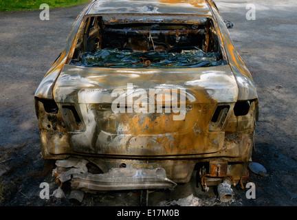 Burned-out car. Scout Scar carpark, Underbarrow Road, Kendal, Cumbria, England, United Kingdom, Europe. - Stock Photo