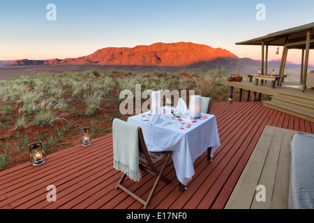 Romantic dining on deck area of mountain view suite.Dunes lodge.Wolwedans NamibRand Nature Reserve.Namibia - Stock Photo