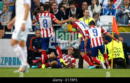 Diego Godin (Atletico Madrid #2 on the floor) with ltr: Raul Garcia (Atletico Madrid #8), Gabi (Atletico Madrid - Stock Photo