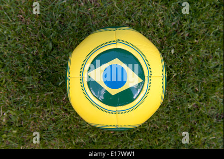 Brazilian football on grass for Brazil World Cup 2014. - Stock Photo