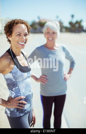 Portrait of smiling women in sportswear outdoors - Stock Photo