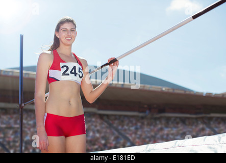 Portrait of high jumper by bar - Stock Photo
