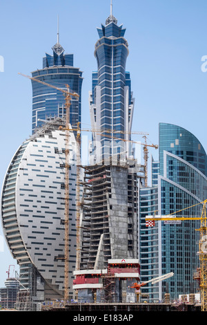 Construction site with many skyscrapers being built in new Business Bay district  in Dubai United Arab Emirates - Stock Photo