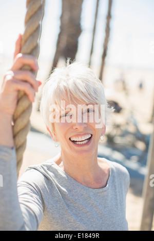 Portrait of enthusiastic senior woman - Stock Photo