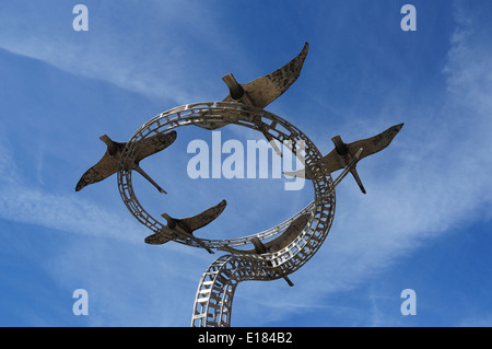 Spirits of Lowestoft. A metal sculpture of Bewick's swans in flight by Charles Normandale, Station Square, Lowestoft, - Stock Photo