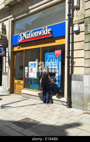dh ATM Cash machines BANKING NATIONWIDE UK SCOTLAND Man building society banks front machine bank cashpoint dispenser - Stock Photo