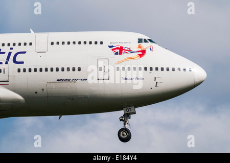 Closeup of the front of a Virgin Atlantic Boeing 747 aircraft as it comes in to land